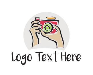 Artistic Camera & Hands logo design