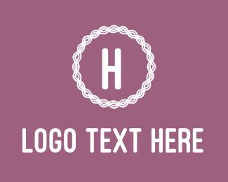 Tailoring - Pink Embroidered H logo design