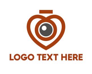 Spy - Heart Eye logo design