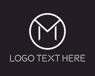 Style - Stylish Letter M Circle logo design