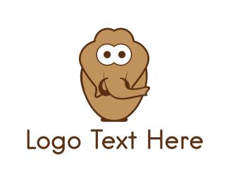 Tusk - Brown Mammoth logo design