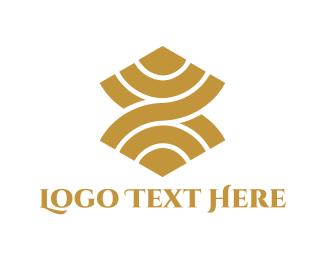 Luxurious - Golden Curves logo design