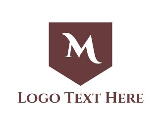 Drapery - Classic M Shield logo design