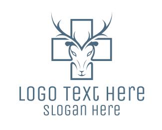 Antelope - Cross & Deer logo design