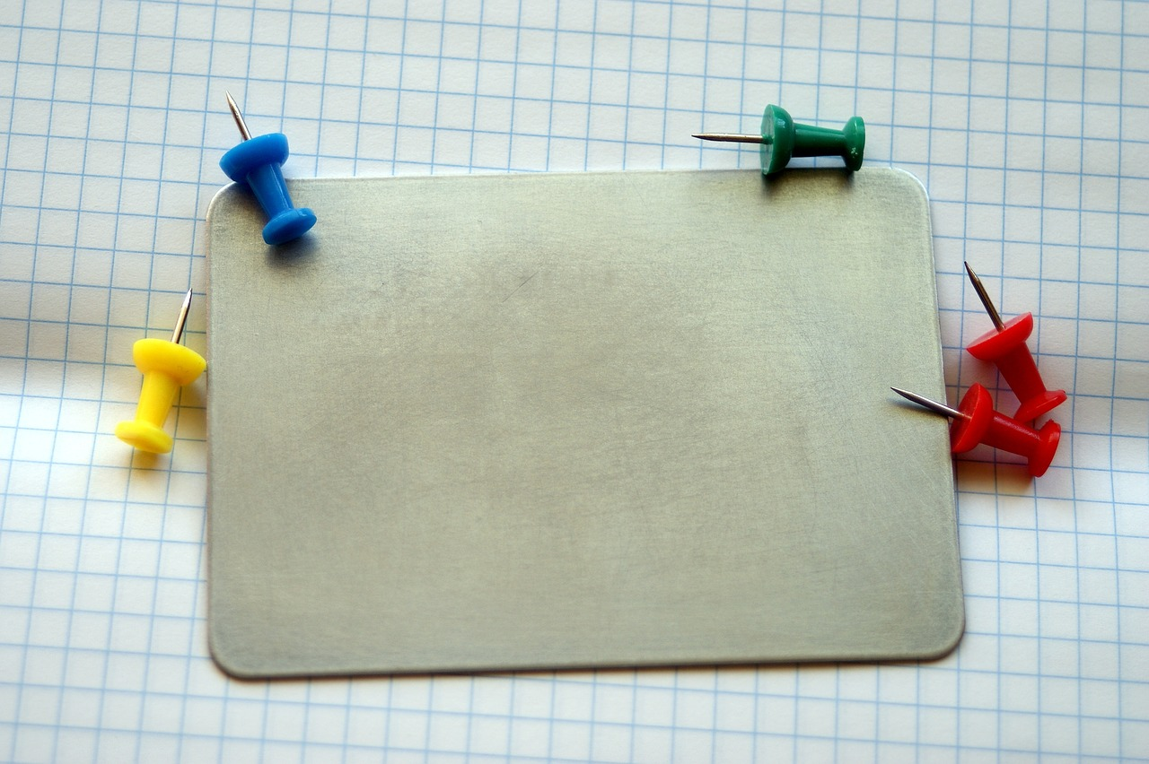 the-header-is-a-stock-image-of-a-board-and-pins